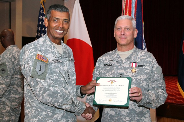 Gen. Vincent K. Brooks, commanding general of U.S. Army Pacific, presents Maj. Gen. James C. Boozer, Sr., the outgoing U.S. Army Japan and I Corps (Forward) commander, with The Distinguished Service Medal, after the change of command ceremony held July 8 at Kastner Army Airfield Hanger in which Boozer relinquished command to Maj. Gen. James F. Pasquarette.