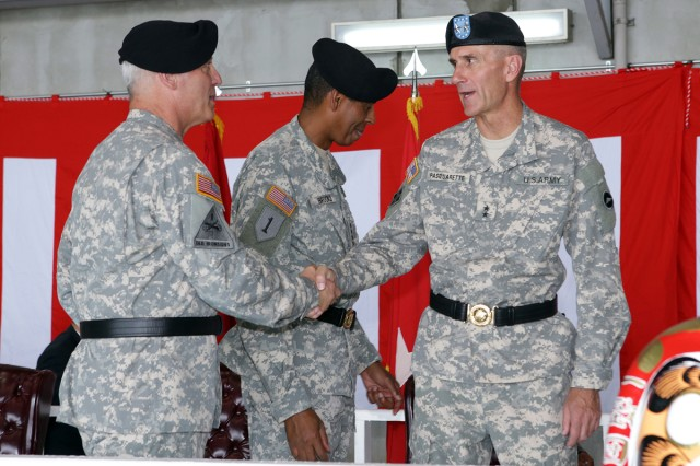 Incoming U.S. Army Japan and I Corps (Forward) Commander, Maj. Gen. James F. Pasquarette, U.S. Army Pacific Commander, Gen. Vincent K. Brooks, and Outgoing USARJ Commander, Maj. Gen. James C. Boozer, Sr., get acquainted before the change of command ceremony held July 8 at Kastner Army Airfield Hanger.