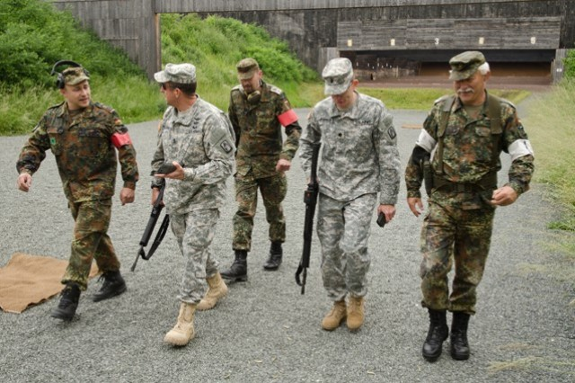 3-158th Assault Helicopter Battalion, 12th Combat Aviation Brigade, battalion Command Sgt. Maj. Hutchings and Commander, Lt. Col. Mark Johnson, are accompanied by Soldiers of the Bundeswher (German Armed Forces)  on June 10, 2015, at the Roth, Germany shooting range, as part of the German and U.S. Armies' marksmanship assessment.