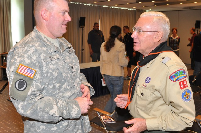 Long-time Scout leader and Distinguished Eagle Scout Dr. Robert Schloesser talks to Col. Jeffrey Dill, former U.S. Army Garrison Wiesbaden commander, during a Boy Scout time capsule unveiling event in Wiesbaden, Germany.
