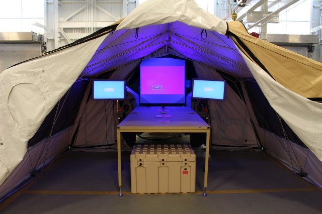 The Light Mobile Command Post, or L-MCP, includes a quick-erect tent, fold-out internet-configured table, monitors and a large screen.  (U.S. Army CERDEC photo by Kathryn Bailey)