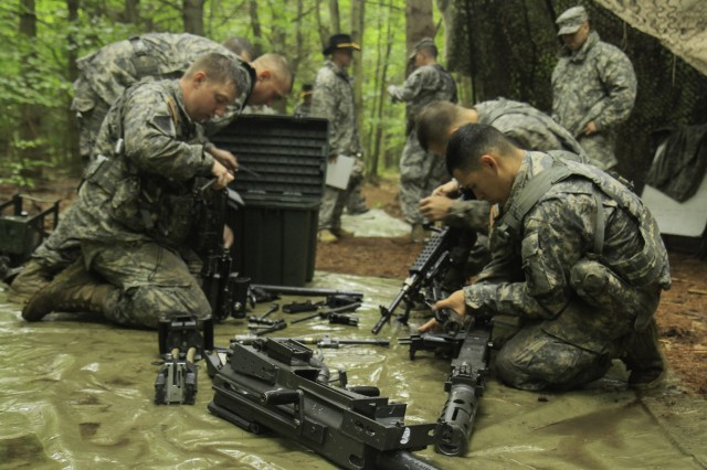 Troopers assigned to 1st Squadron, 89th Cavalry Regiment, 2nd Brigade Combat Team, assemble multiple weapon systems during the weapons assembly and disassemble event of their Spur Ride held on Fort Drum July 14-16.