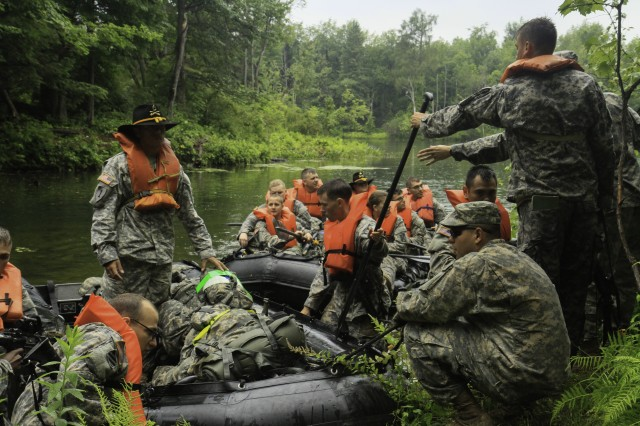 Troopers assigned to 1st Squadron, 89th Cavalry Regiment, 2nd Brigade Combat Team, dismount a zodiac boat after completing the water crossing event during their spur ride held on Fort Drum July 14-16.