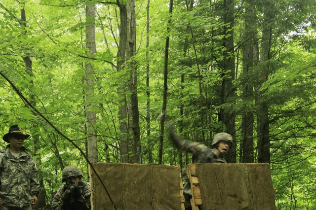 Troopers assigned to 1st Squadron, 89th Cavalry Regiment, 2nd Brigade Combat Team, throw a hand grenade from the standing position during the hand grenade and bayonet assault course event of their Spur Ride held on Fort Drum July 14-16.