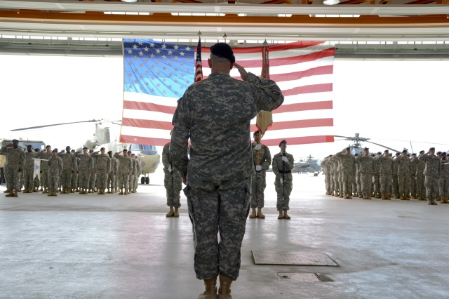Lt. Col. David K. Almquist, the battalion commander for 412th ASB, 12th Combat Aviation Brigade, stands at the head of his formation and salutes during the playing of the national anthem at the unit's inactivation ceremony at Katterbach Army Airfield in Ansbach, Germany, July 21, 2015.  The unit is inactivating due to the U.S. Army's Aviation Restructuring Initiative, which is designed to reorganize and reposition aviation assets across the Army.  (U.S. Army photo by Spc. Nicholas Redding, 12th CAB)