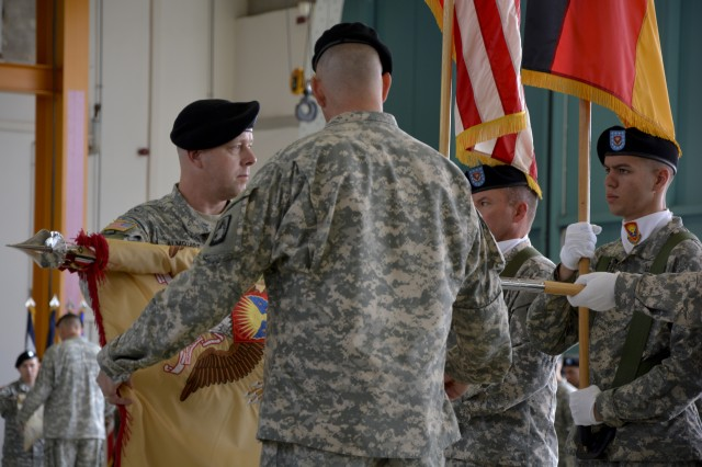 Lt. Col. David K. Almquist and Command Sgt. Maj. James S. Halchishick the command team for 412th ASB, 12th Combat Aviation Brigade, case the battalion colors during the unit's inactivation ceremony at Katterbach Army Airfield in Ansbach, Germany, July 21, 2015.  The unit is inactivating due to the U.S. Army's Aviation Restructuring Initiative, which is designed to reorganize and reposition aviation assets across the Army.  (U.S. Army photo by Spc. Nicholas Redding, 12th CAB)