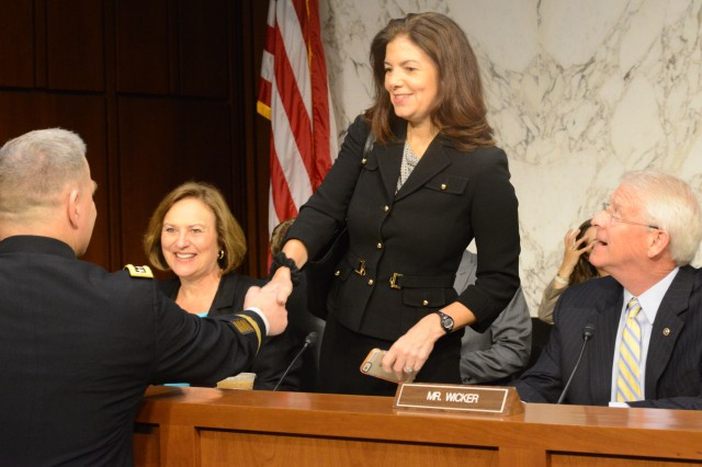Gen. Mark A. Milley greets Sen. Kelly Ayotte (R-NH) before a Senate Armed Services Committee hearing regarding Milley's nomination to become the next Army chief of staff, July 21, 2015.