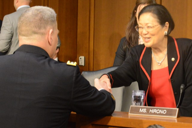 Gen. Mark A. Milley greets Sen. Mazie K. Hirono (D-HI) before a Senate Armed Services Committee hearing regarding Milley's nomination to become the next Army chief of staff, July 21, 2015.