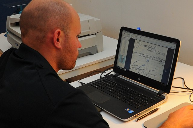 Air Force veteran Joshua Williamson does quality control scans of archaeological field notes at the Alexandria, Va., lab of the Veterans Curation Program.