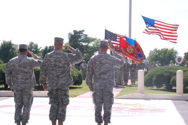 Col. Paul Hossenlopp, Col. Tracy Banister and Maj. Gen. John Rossi salute the flag during a retreat ceremony July 17, 2015, in front of McNair Hall here. The ceremony served to bid farewell to Banister while welcoming Hossenlopp as the new Fires Center of Excellence chief of staff.