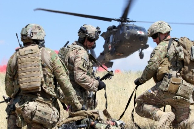 Soldiers evacuate a simulated casualty during a combined arms live-fire training exercise  (U.S. Army photo by Capt. Charlie Emmons, TAAC-E Public Affairs)