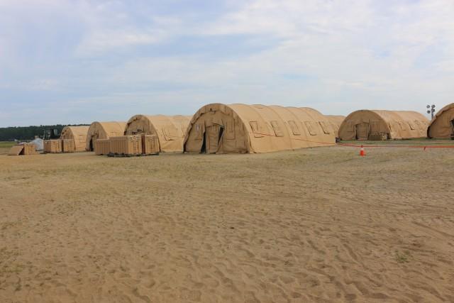Setting up troop sleeping quarters.
