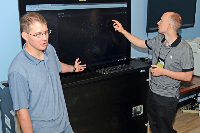 "Capt. James McColl and Capt. Justin Lanahan, both cyber officers at U.S Army Cyber Command, took part in a week-long ""hackathon"" in Arlington, Va., July 20-24, 2015, in support of the continued development of ""Plan X,"" a four-year, $120 million program at the Defense Advanced Research Projects Agency."
