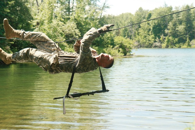 Sgt. Michael Parks, C Troop, 1-89 Cavalry, navigates a single-rope bridge at the water-crossing lane during the McChrystal-Briles Competition on Fort Drum.