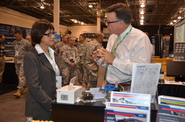 The Hon. Heidi Shyu, ASA(ALT), visits industry exhibits during the 2014 GVSETS