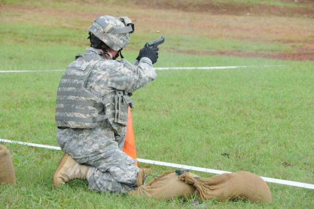 A Soldier from the 311th Signal Command fires his M9 at a target July 16, 2015. Soldiers were shooting for their semi-annual M9 and M16 recertification at the Schofield Barracks range.