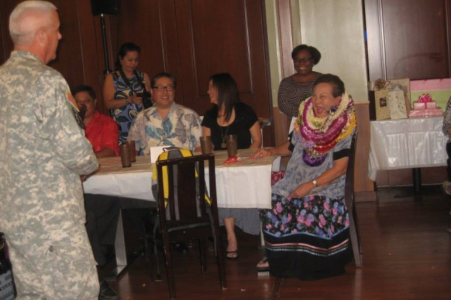 Ms. Loo and her guest share a moment of laughter and smiles at Tsukiji Fish Market & Restaurant in Honolulu, Hi. Soldiers, Officers, Civilians, and retirees, who have known her throughout the 54 years of civial service, express their admiration and gratitude at Ms. Loo's retirement dinner on Jan. 14, 2015.