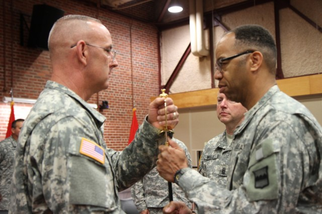 Command Sgt. Maj. Jeffrey Darlington, (left) accepts the noncommissioned officer sword from Maj. Gen. A.C. Roper, commander 80th Training Command (TASS), during a change of responsibility ceremony, Richmond, Va., Aug. 2, 2015. By accepting the sword Darlington officially became the 80th's command sergeant major.