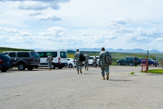 U.S. Army Reserve Soldiers with the, 7243rd Installation Medical Support Unit, head to their vehicles after a 14-hour work day assisting patients on Fort Belknap Indian Reservation, Mont., July 28, 2015. U.S. Army Reserve Soldiers conducted innovative readiness training at the Fork Belknap Indian Reservation, providing medical support to the local community hospital and clinics.