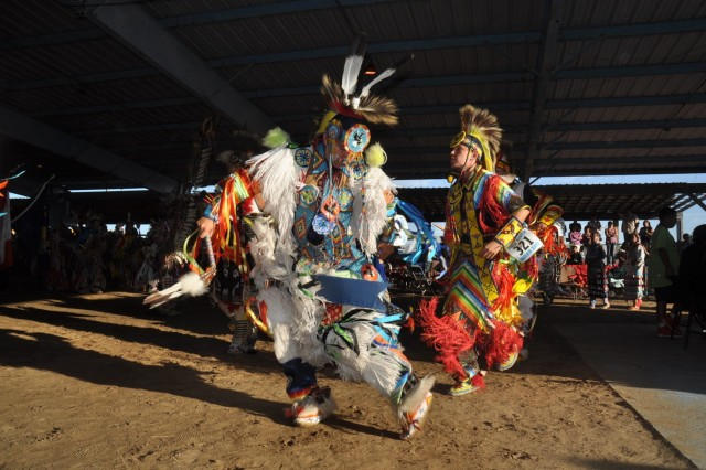 Local tribe members at the Fort Belknap Indian Reservation, dressed in cultural garb, help highlight the culture of their heritage through dance during a pow-wow ceremony on the reservation, which honored the U.S. Army Reserve guest. Army Reserve Soldiers conducted innovative readiness training at the Fork Belknap Indian Reservation, providing medical support to the local community hospital and clinics.