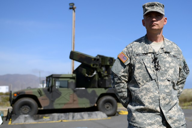 Army Master Sgt. Christopher Williams of the South Carolina National Guard speaks to the media at Naval Base Ventura County and Sea Range, Point Mugu, Calif., July 31, 2015. Williams was taking part in Black Dart 2015, a DOD-sponsored counter-UAS demonstration, July 26 to Aug. 7. He was explaining the system seen behind him, the Avenger Air Defense System.