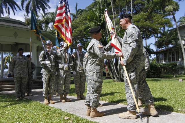 Maj. Gen. Kevin O'Connell, the Army Sustainment Command commanding general, passes the 402nd Army Field Support Brigade colors to Col. Anthony McQueen, the incoming 402nd commander, signifying his acceptance of command of the unit at the Historic Palm Circle gazebo, Fort Shafter, Aug. 3. This is the first 402nd change of command and responsibility ceremony held outside of the Army Central Command area of responsibility. The change of command and responsibility signifies the relinquish of control from the outgoing command team to the incoming command team.