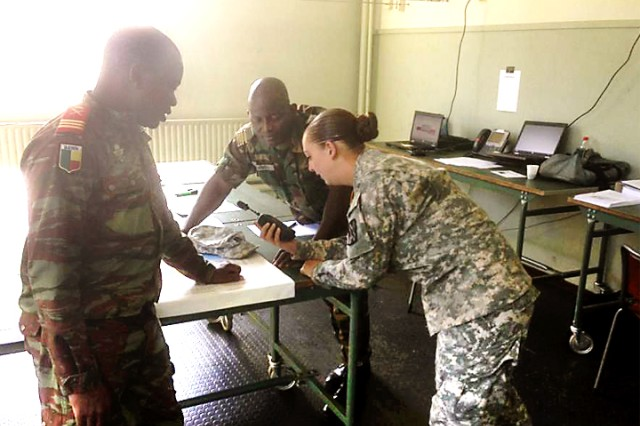 Spc. Jensen (right) tests the SQ.410 Translation System with Capt. Ali Oruo of Benin (left) and Maj. Pawipadi of Togo at the African Western Accord Exercise 15 in the Netherlands.