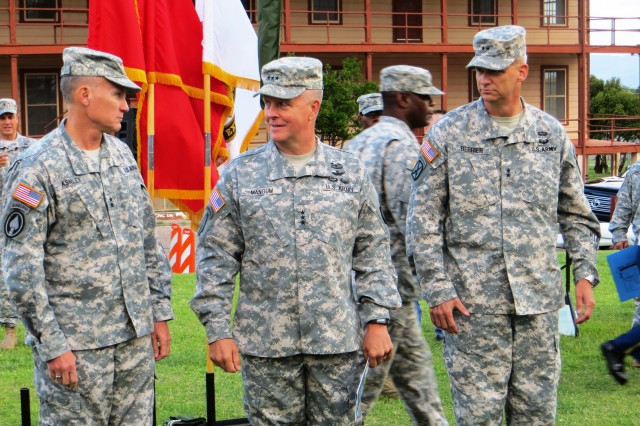 From left, Maj. Gen. Robert P. Ashley, outgoing commander, U.S. Army Intelligence Center of Excellence and Fort Huachuca; Lt. Gen. Kevin W. Mangum, deputy commanding general/chief of staff, U.S. Army Training and Doctrine Command; Maj. Gen. Scott D. Berrier, incoming commander, USAICoE and Fort Huachuca, stand ready for the ceremony on Brown Parade Field.