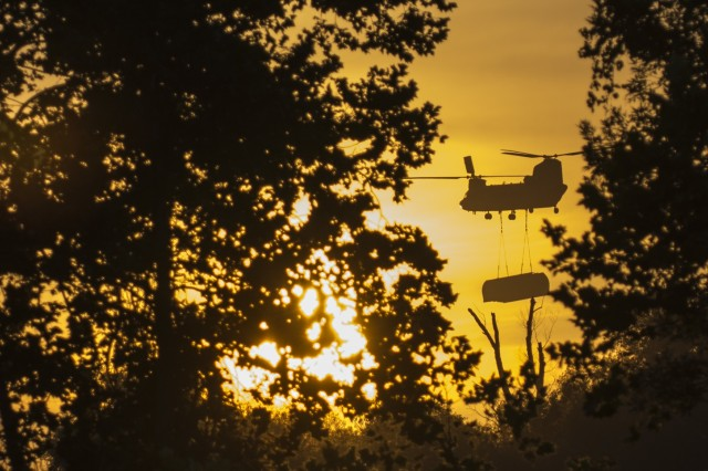 A CH-47 Chinook helicopter flown by Bravo Company, 7th Battalion, 158th Aviation Regiment, out of Fort Hood, Texas, carries an improved ribbon bridge bay to the Arkansas River during Operation River Assault 2015, a bridging training exercise involving Army Engineers and other support elements to create a modular floating bridge on the water at Fort Chaffee, Ark., Aug. 4. The entire training exercise lasted from July 28 to Aug. 4, 2015, involving one brigade headquarters, two battalions and 17 other units, to include bridging, sapper, mobility, construction and aviation companies. (U.S. Army photo by Master Sgt. Michel Sauret)