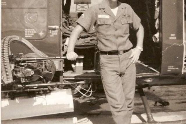Elmore poses beside a gunship.