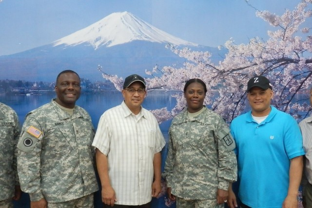 From left: 1st Sgt. Deon Cain, chief culinary management NCO, DA-G4; Sgt. Maj. Ricky Gaines, culinary management sergeant major, DA G-4; Alan Domingo, DFAC manager, LRC-Honshu; Chief Warrant Officer 4 Anita Williams, management assistance division, DA G-4; Brad Richardson, food program manager, LRC-Honshu; and Roderick Piggott, facilities and equipment specialist, DA G-4, pose for a picture upon completion of the Camp Zama Dining Facility evaluation, June 10. (Photo courtesy of 403rd AFSB)