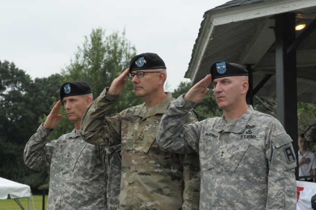 Lt. Gen. Michael S. Tucker (center), First Army commanding general; First Army Division East outgoing commanding general, Maj. Gen. Jeffrey L. Bailey (left); and Division East incoming commanding general, Maj. Gen. Brian J. McKiernan, salute the flag during a change of command ceremony at Fort George G. Meade, Md., Aug. 7.