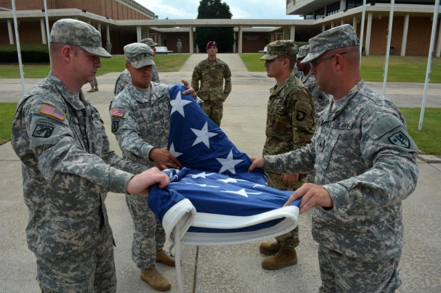Retiring the colors Tuesday at the Signal Towers pole, in keeping are members of the Regimental Noncommissioned Officer Academy's advanced leaders course.