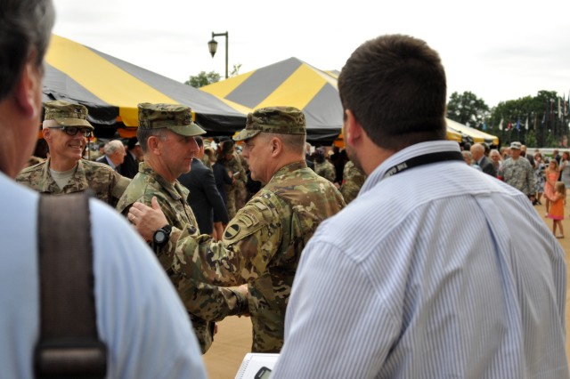 FORT BRAGG, N.C. (Aug. 10, 2015) - Gen. Mark A. Milley (right) says farewell to Gen. Robert B. Abrams after the U.S. Army Forces Command change of command ceremony here today during which Milley relinquished command to Abrams.  Abrams became the 22nd FORSCOM commanding general and Milley will depart Fort Bragg for Washington, D.C., where he will become the 39th Chief of Staff of the U.S. Army.  Also seen is Col. Daniel J. W. King, FORSCOM director of public affairs.
