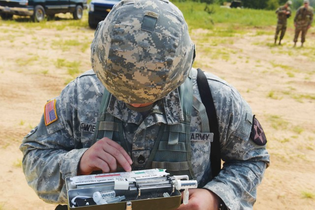 A Soldier performs one of the hourly checks on a wet bulb to determine the current heat level during a field training exercise on Fort Benning, Ga.