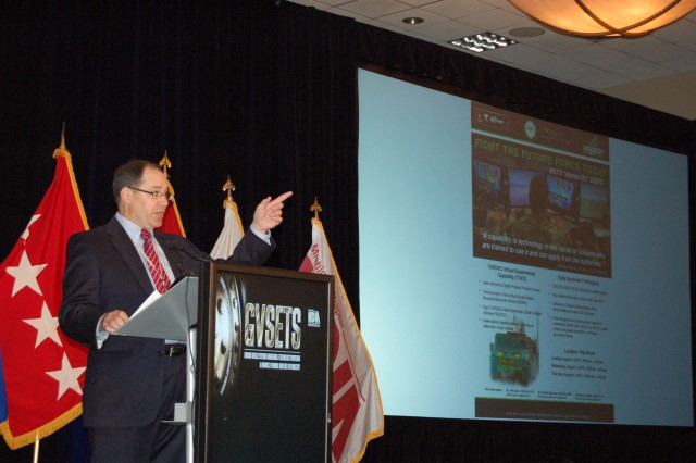 Dr. Paul Rogers, Director, U.S. Army Tank Automotive Research, Development and Engineering Center, delivers the opening address to the 2015 Ground Vehicle Systems Engineering & Technology Symposium in Novi, Mich., August 4, 2015.  The 3-day event featured addresses, panels and expositions highlighting the latest innovations in military ground vehicle development.
