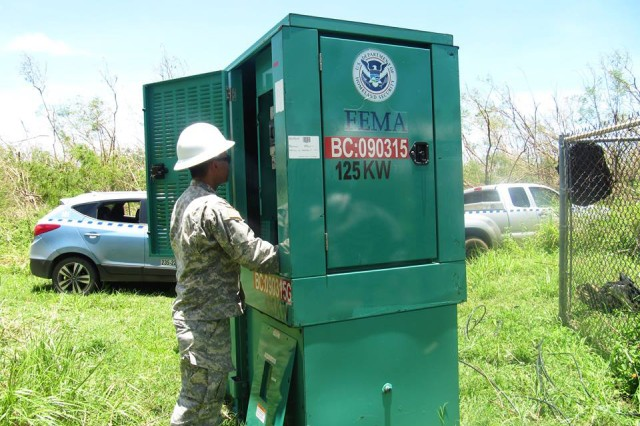 SAIPAN, CNMI (August 9, 2015) -- A Soldier from the U.S. Army's 249th Engineer Battalion, U.S. Army Corps of Engineers, installs a generator to power water pumps in Saipan as part of the federal response to Typhoon Soudelor. The 249th Engineer Battalion, contractors, and commonwealth and local entities are assessing, installing, and maintaining emergency generators at critical facilities, especially at wells to ensure that residents of Saipan get a much needed supply of drinking water. The 249th , along with a Power Planning Response Team from the Corps' Honolulu District, is on the ground now, making a huge difference, and includes specialists for contracting, liaisons, mission management, data management, logistics, and quality assurance. One Team -- Building Strong�!