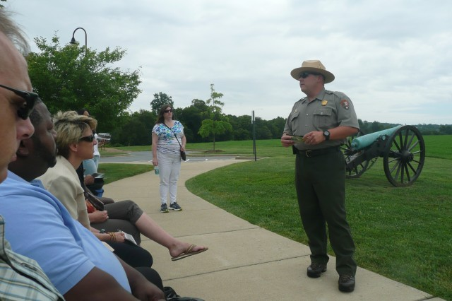 A tour guide starts off the Monocacy battlefield tour with an overview of the history of the Civil War and a display of an authentic canon.