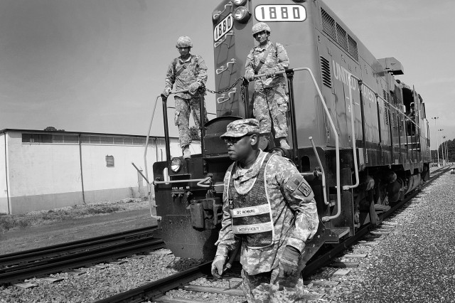 Sgt. 1st Class Elrick Richburg, 2nd staff and faculty instructor at the Transportation School, walks along the tracks during his support of Warrior Week, the advanced individual training field training exercise on Joint Base Langley-Eustis, Va., July 30, 2015.