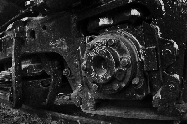 The rail wheel of a 120-ton diesel locomotive is symbolic of the power and danger associated with railway operations.