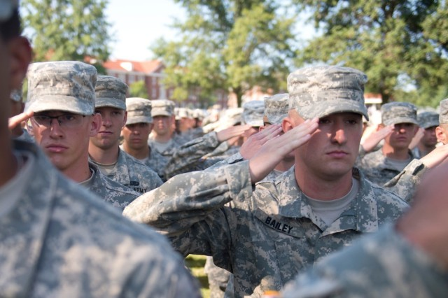 Cadets stand at salute for the last time at Cadet Summer Training after the graduation ceremony at Brooks Field at Fort Knox Aug. 13. The families of Cadet Leader Course 10th Regiment came to Fort Knox to see their cadets graduate from Cadet Summer Training.