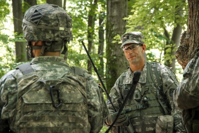 Command Sgt. Maj. Harold E. Dunn IV, right, the 20th Chemical, Biological, Radiological, Nuclear, Explosives, or CBRNE, Command senior enlisted leader, speaks with Soldiers during the second iteration of the CBRNE Leaders Course at Gunpowder Range, Maryland, Aug. 11, 2015.