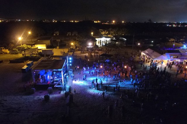 Originally billed as a two-day event, the Caribbean Party at Torii Station was shifted right by one day to Aug. 8. Through a mostly calm evening, thousands gathered to take part in the record-setting beach bash.