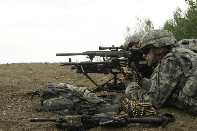 Soldiers assigned to B Company, 2nd Battalion, 87th Infantry Regiment, 2nd Brigade Combat Team, suppress a notional enemy with synchronized rifle fire during a platoon live fire exercises on Fort Drum Aug. 14.This tactic known as support by fire, helps keep the enemy at bay while an advancing party closes the distance and eliminates hostel personnel.