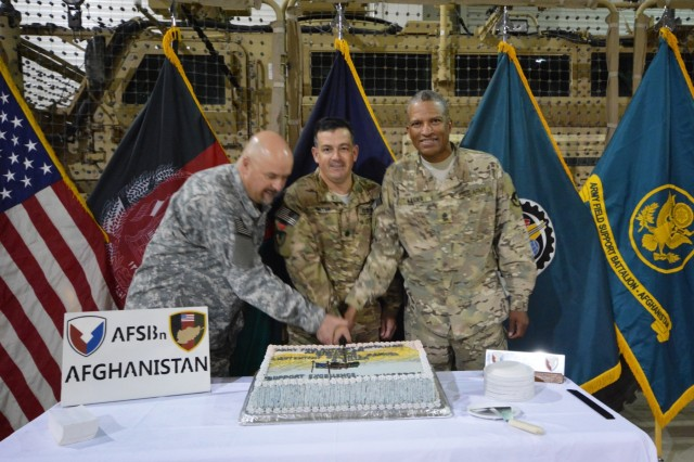 Gene Shearer, Army Field Support Battalion-Afghanistan deputy to the commander (left), Lt. Col. Samuel S. Miller, AFSBn-AFG commander (center) and Sgt. Maj. Tyrone P. Legier (right), AFSBn-AFG senior noncommissioned officer cut a cake Aug. 5, 2015, following a change of command ceremony in which Miller assumed command from Lt. Col. Mark W. Susnis during a change of command ceremony at Bagram Air Field.