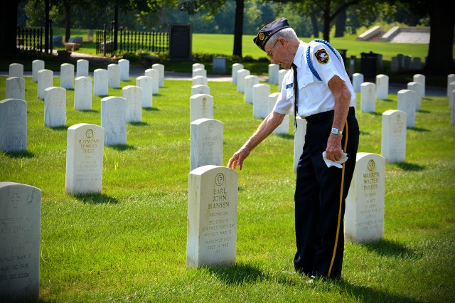 Harry Hansen, a 94-year-old World War II veteran visits his younger brother's grave before the Spirit of '45 memorial ceremony at the Rock Island Arsenal National Cemetery, Aug. 16. (Photo by Justin Graff, ASC Public Affairs)