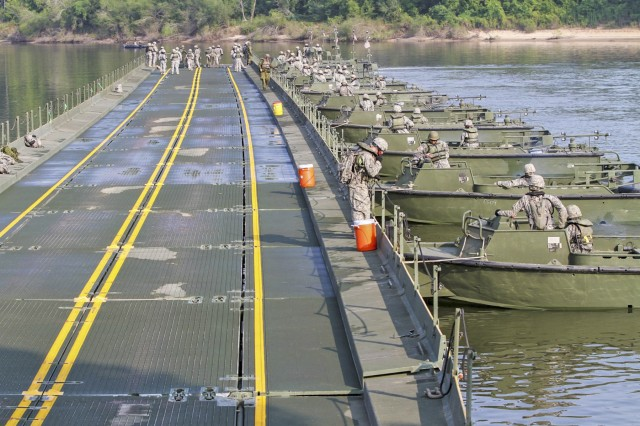 Engineers construct an Improved Ribbon Bridge. Fort Leonard Wood's 50th Multi Role Bridge Company, 5th Engineer Battalion, assembled an IRB that spanned 142 meters across the waters of Training Area 250, during training Operation Moses held Aug. 12.