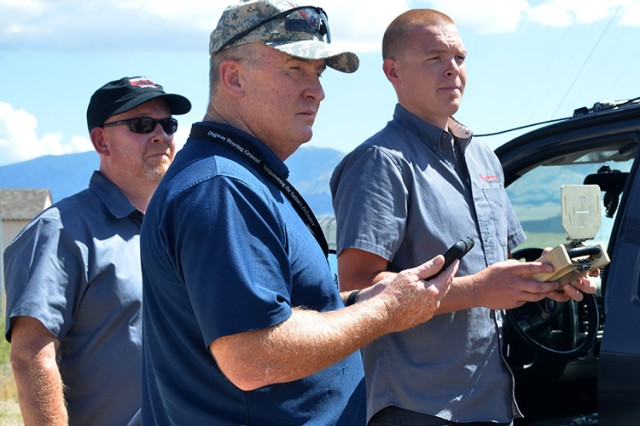Troy Takach, Kairos Autonomi's president and CEO, Gen. (retired) Rick Lynch of R Lynch Enterprises and Tanner Thorton, the pilot of thePronto4™ Uomo Applique' Kit unmanned ground vehicle is put through its paces Aug. 13,2015  at U.S. Army Dugway Proving Ground, Utah.