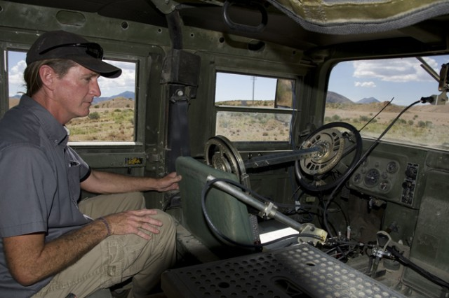 An inside view of Pronto4™ Uomo Applique' Kit as it moves down the test range at U.S. Army Dugway Proving Ground in a Humvee. Blaine Deveraux, the system's program manager, oversees the operation from the backseat.