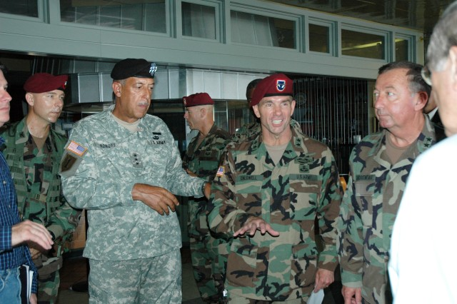 Lt. Gen. Russel L. Honoré, commander of Joint Task Force Katrina, then-Maj. Gen. William B. Caldwell, and then-adjutant general of Louisiana, Maj. Gen. Bennett C. Landreneau, meet with reporters at New Orleans International Airport to discuss relief operations for Hurricane Katrina, Sept. 4, 2005. Donald Rumsfeld, defense secretary at the time, is shown at the right of the image with his back to the camera.